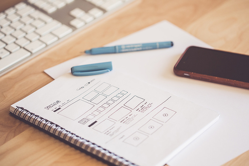 UX wireframes drawn on paper
