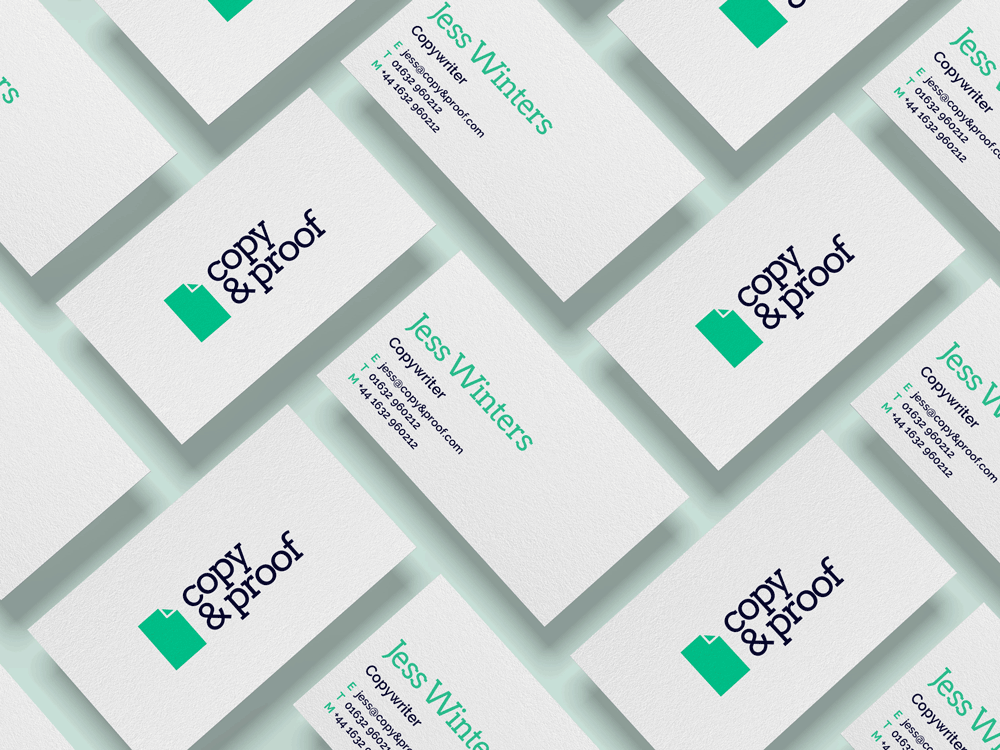 Mock up of Copy and Proof logo on business cards
